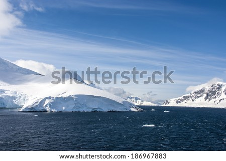 Antarctica - Antarctic Peninsula - Palmer Archipelago - Neumayer Channel - Global warming - Fairytale landscape / Antarctica - Blue sky - stock photo