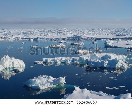 Antarctica blue iceberg landscape ocean mirror reflection - stock photo