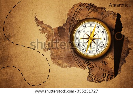 Antarctica map and Compass old paper Over White Background, Elements of this image furnished by NASA (Satellite map of Antarctica) - stock photo