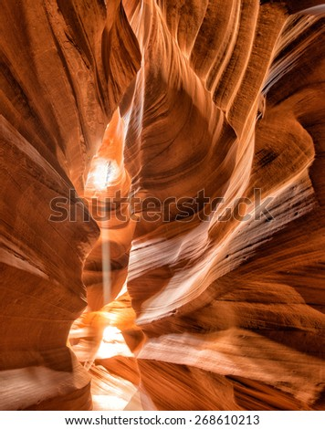 Antelope Canyon view with light rays on sand floor - stock photo