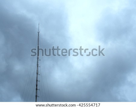Antenna And cloudy sky,mast or other device used to transmit or receive radio or television signals  - stock photo