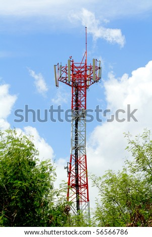 Antenna behind green forest - stock photo