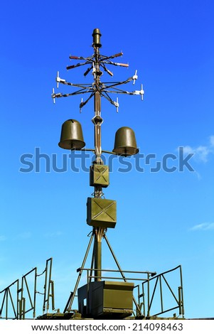 Antenna direction finder with a device identification in a military vehicle - stock photo