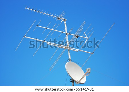 antenna for TV on blue sky background - stock photo