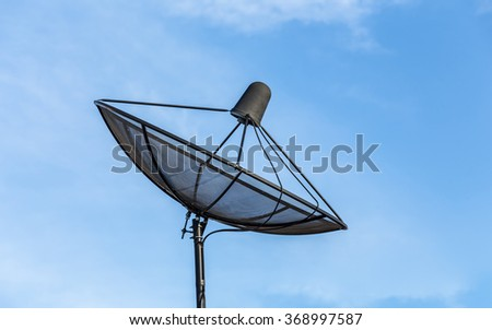 Antenna in front of blue sky background - stock photo