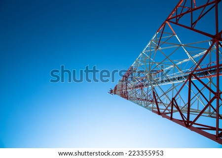 Antenna of communication building and blue sky - stock photo