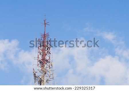 Antenna of communication tower and blue sky background - stock photo