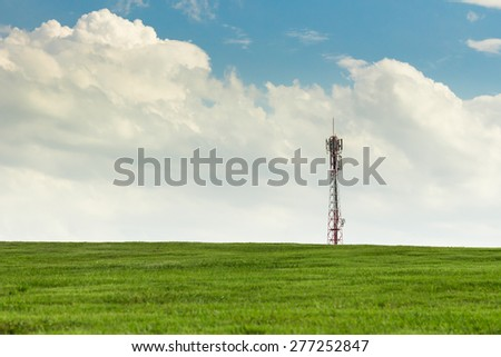 antenna on the grassy knoll and blue sky. - stock photo