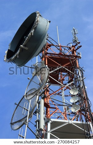 antenna repeater tower on blue sky - stock photo