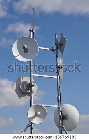 Antennas, cellular systems on a steel mast - stock photo