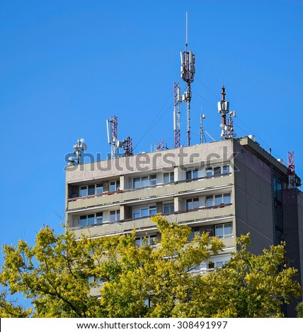 Antennas on the top of a high apartment building - stock photo