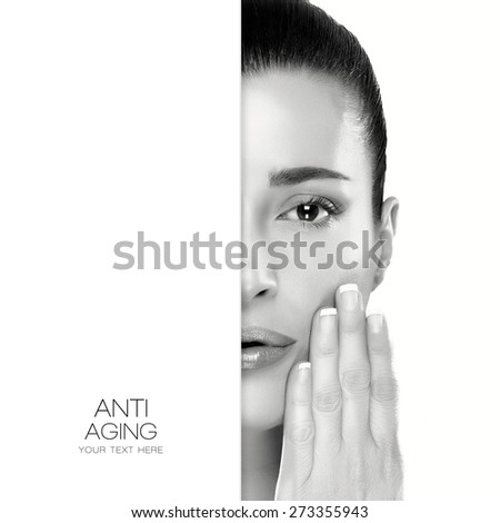 Anti Aging and skincare concept. Monochrome half face portrait of a serene young woman with her manicured nails raised to her cheek and a flawless smooth complexion. Template design with sample text - stock photo