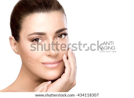 Anti aging treatment and plastic surgery concept. Beautiful young woman with hand on cheek and a friendly expression in a beauty, skincare and spa concepts. Perfect skin. Portrait isolated on white - stock photo