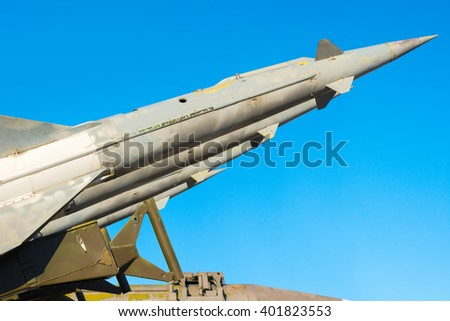 anti aircraft rockets of a surface-to-air missile system are aimed at the blue sky, close up - stock photo