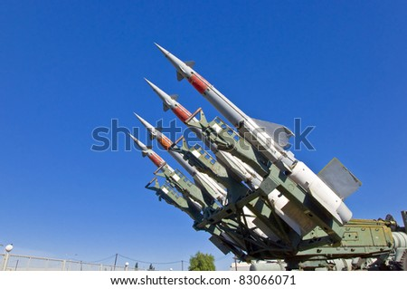 Antiaircraft rockets on the launcher against blue sky. - stock photo