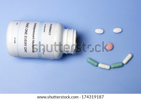 Antidepressant medication forms a happy face. - stock photo