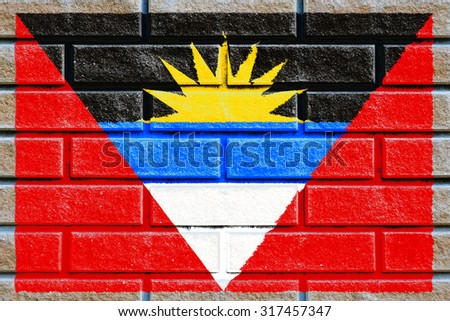 Antigua and Barbuda flag painted on old brick wall texture background - stock photo