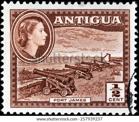ANTIGUA - CIRCA 1956: A stamp printed by ANTIGUA shows view of old cannons in Fort James. Fort James is a fort at the entrance to the harbor of St. John's, Antigua and Barbuda, circa 1956 - stock photo