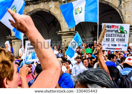 "Antigua, Guatemala - August 27, 2015: Locals protest against government corruption & demand resignation of President Otto Perez Molina. Sign reads ""No more corruptionists. Guatemala isn't for sale"". - stock photo"