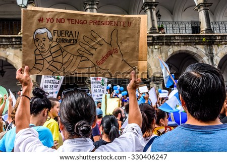 "Antigua, Guatemala - August 27, 2015: Locals protest against government corruption & demand resignation of President Otto Perez Molina. Sign reads "" I don't have a president. Get out corruptionist"". - stock photo"
