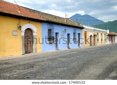 Antigua Guatemala in Central America. Early morning cobble stone streets, and colorful houses. - stock photo
