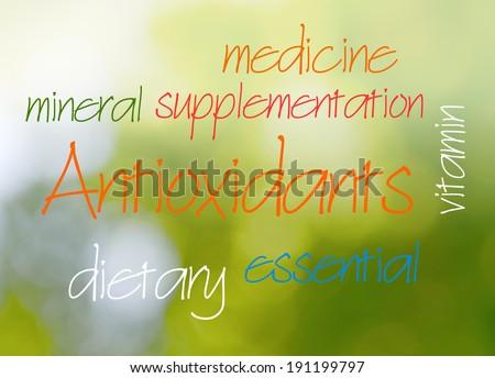 Antioxidant word cloud on green bokeh background - stock photo