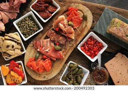 antipasti antipesto antipasta selection on table - stock photo