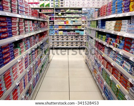 ANTIPOLO CITY, PHILIPPINES - NOVEMBER 19, 2015: Oral care products and table napkins on the shelves of a grocery store in Antipolo City, Philippines - stock photo
