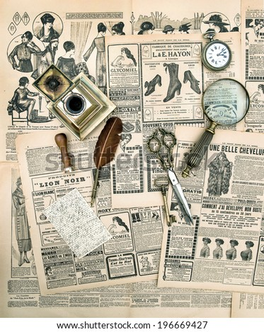 antique accessories and writing tools, vintage fashion magazine for the woman. aged paper background - stock photo