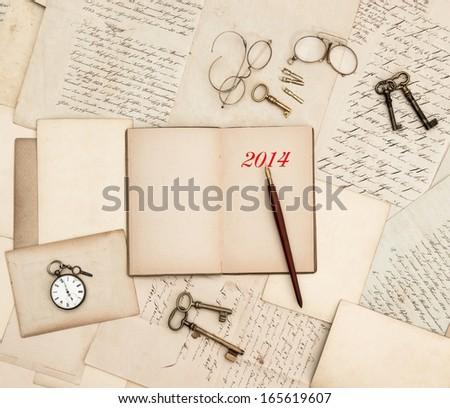 antique accessories, old letters, watch and keys. vintage nostalgic background with diary for 2014 - stock photo