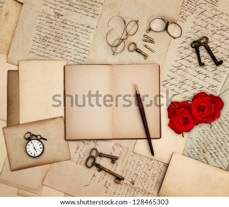 antique accessories, old letters, watch, red rose flowers and keys. sentimental nostalgic background - stock photo