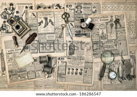 antique accessories, sewing and writing tools, vintage fashion magazine for the woman. collectibles. retro style toned picture - stock photo
