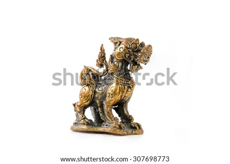 Antique asian art, brass singha, Thailand tradition lion god. perspective view of golden lion - stock photo