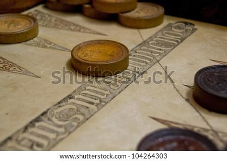 Antique backgammon board - stock photo