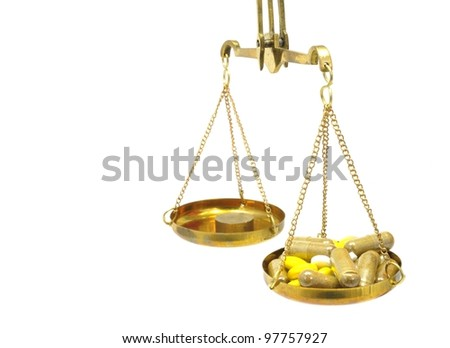 antique balance scale with medicine on white background - stock photo