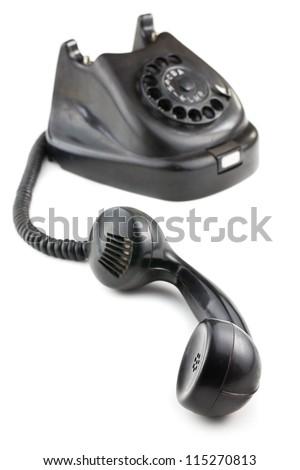 antique black phone on white background - stock photo
