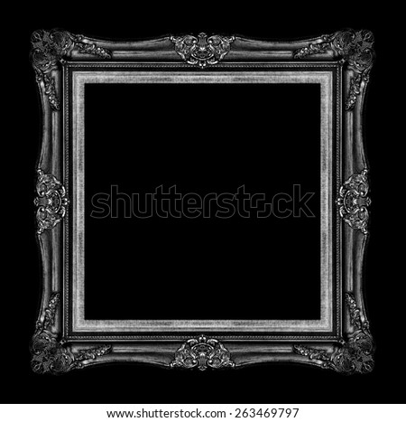 antique black picture frame isolated on black background - stock photo