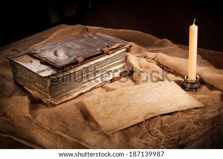 antique book, paper and candle - stock photo