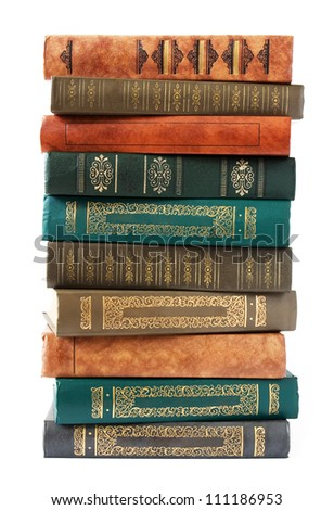 Antique book pile isolated on white background - stock photo