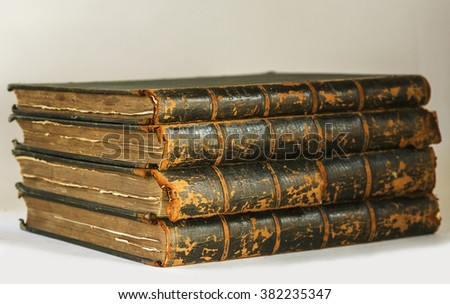 Antique books with frayed pages  pile  on white background - stock photo