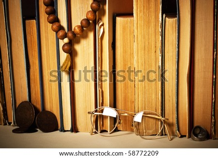 antique books with old russian coins and glasses - stock photo