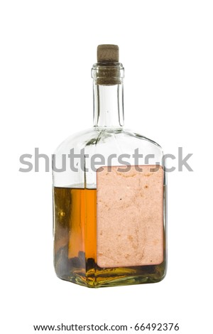 Antique bottle of spirits, isolated over a white background - stock photo