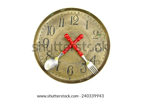 antique brass clock face dial with flatware arrows isolated on white background - stock photo