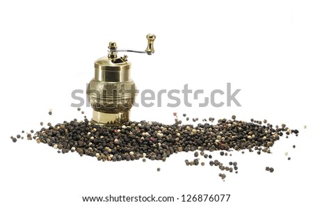 antique brass pepper mill with peppers - stock photo
