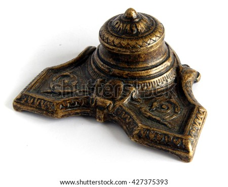 Antique Bronze inkpot on white background with shadows - stock photo