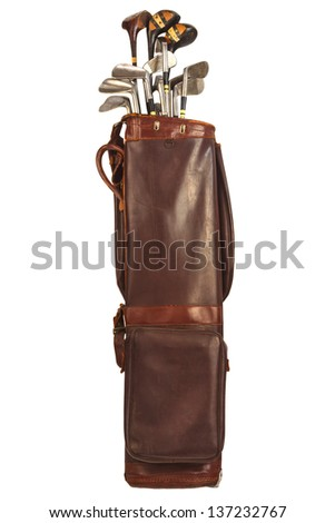 Antique brown leather bag with steel and wooden golf clubs isolated on a white background - stock photo
