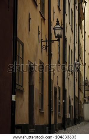Antique buildings in a dark and narrow alley in Stockholm old town (Gamla stan), Sweden - stock photo