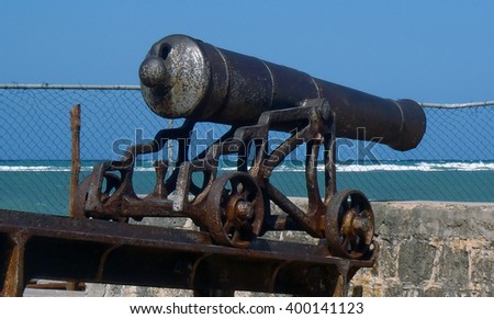 Antique canon on the Caribbean sea - stock photo
