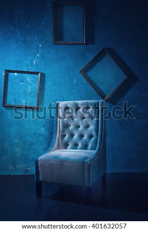 Antique chair against a grungy brick wall - stock photo