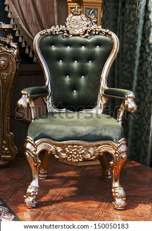 antique chair upholstered in velvet in the interior of the palace - stock photo
